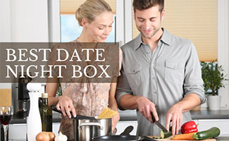 Couple cooking together (caption: Best Date Night Box)
