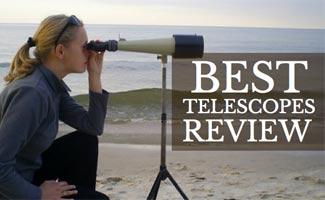 Girl on beach looking through telescope