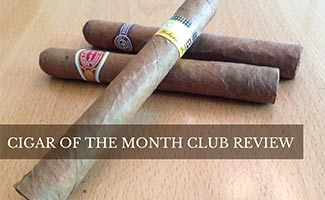 3 cigars on wood table (caption: Cigar Of The Month Club Review)