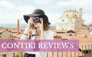 Woman taking photo while traveling: Contiki Reviews