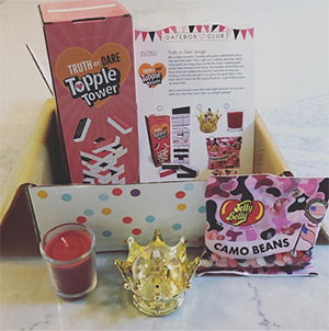 DateBox Club sample box with candy and candle