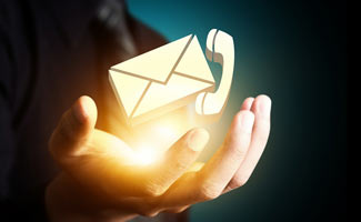 Hands with mail and phone: Contact Us