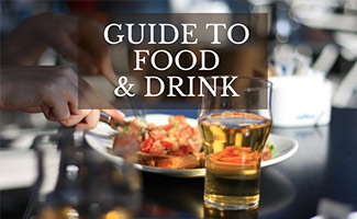 Plate of food with beer (caption: Guide to Food & Drink)