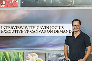 Gavin standing in front of wall (caption: Interview with Gavin Jocius)