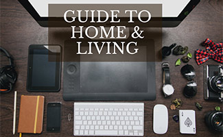 Computer and tech gadgets on desk (caption: Guide to Home & Living)