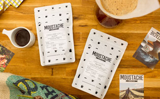 Moustache Coffee Club pouches on counter