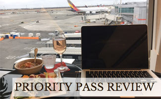Laptop and food in airport lounge