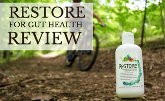 Bottle of Restore on trail with mountain biker