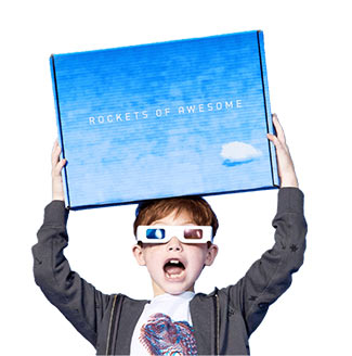 Boy with 3D glasses holding Rockets of Awesome box