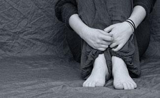 Sad person's legs black and white