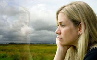 Sad Woman staring out window